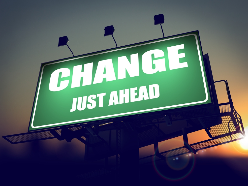 Change Just Ahead - Green Billboard on the Rising Sun Background.