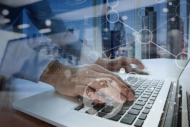 businessman hand working with modern technology and digital layer effect as business strategy concept.jpeg
